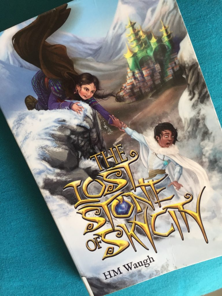 Cover of book The Lost Stone of Sky City, with a girl clinging to the hand of a boy who is hanging over an abyss.